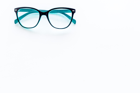 Glasses with transparent optical lenses on white background top view. Stock Photo