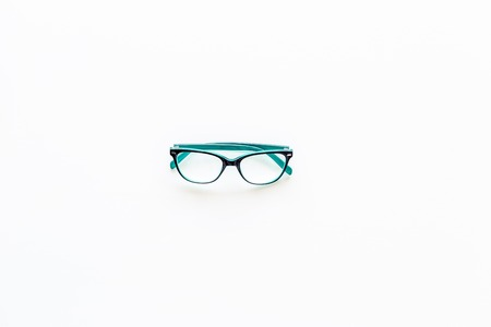 Glasses with transparent optical lenses on white background top view. Stock Photo - 108110824
