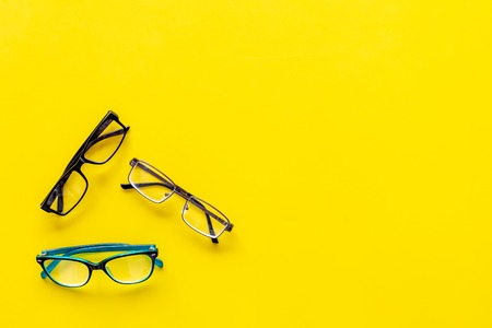 Glasses with transparent optical lenses on yellow background top view. Stock Photo - 108110948