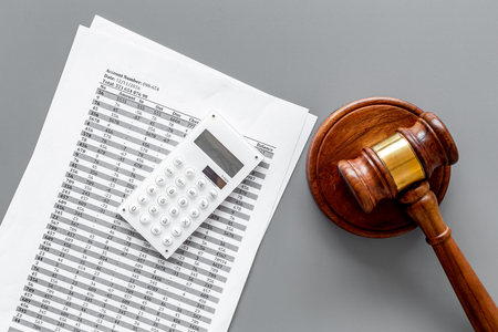 Declare bankruptcy concept. Start of bankruptcy procedure. Judge gavel, financial documents, calculator on grey background top view. Фото со стока