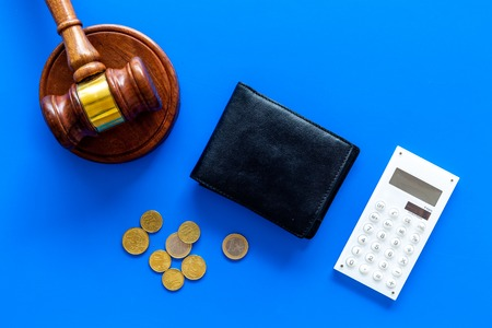 Financial failure, bankruptcy concept. Judge gavel, wallet, coins, calculator on blue background top view copy space Stock Photo