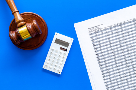 Declare bankruptcy concept. Judge gavel, financial documents, calculator on blue background top view. Фото со стока