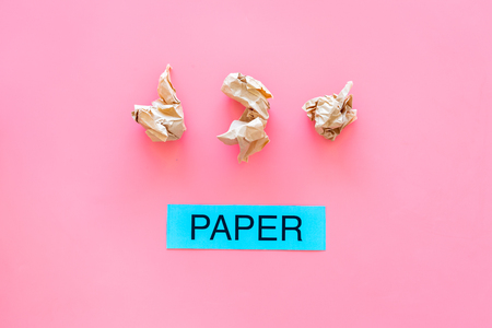 Waste suitable for recycle. Crumpled paper near printed word paper on pink background top view. 스톡 콘텐츠