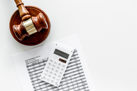 Declare bankruptcy concept. Judge gavel, financial documents, calculator on white background top view copy space
