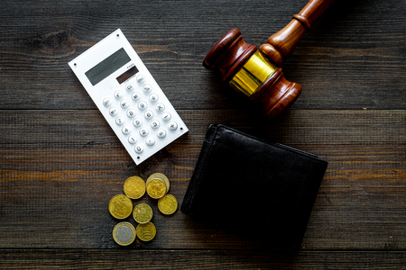Financial failure, bankruptcy concept. personal bankruptcy. Judge gavel, wallet, coins, calculator on dark wooden background top view Standard-Bild - 108384856