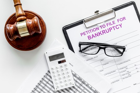 Petition to file for bankruptcy. Empty form ready to fill near calculator and judge gavel on white background top view space for text Stockfoto