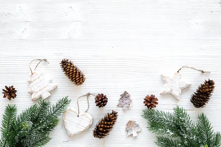 Christmas background. Spruce branch, cones and toys for decoration on white background top view