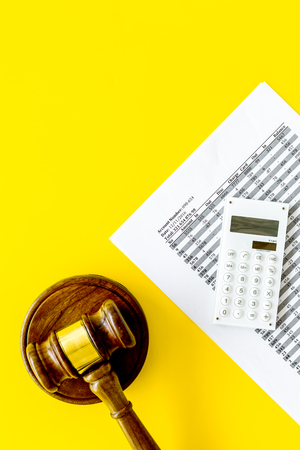 Declare bankruptcy concept. Judge gavel, financial documents, calculator on yellow background top view copy space Stock Photo