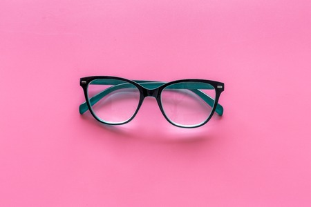 Glasses with transparent optical lenses on pink background top view space for text closeup Stock Photo