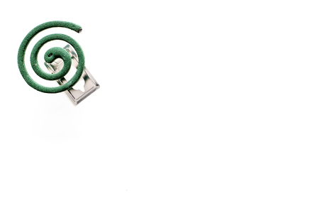 Mosquito repellent for outdoor: garden, summer house, picnic. Green spiral on white background top view space for text Archivio Fotografico - 108576069