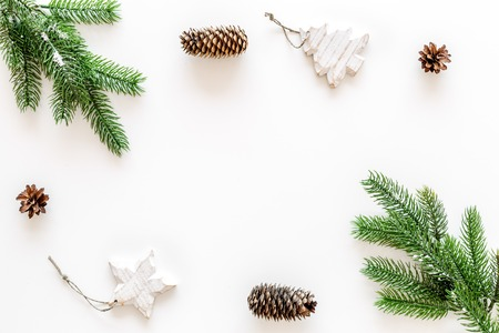 Decoration for winter holidays concept. Christmas, New year. Spruce branch, cones and toys on white background top view copy space Stock fotó