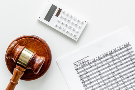 Declare bankruptcy concept. Judge gavel, financial documents, calculator on white background top view Фото со стока