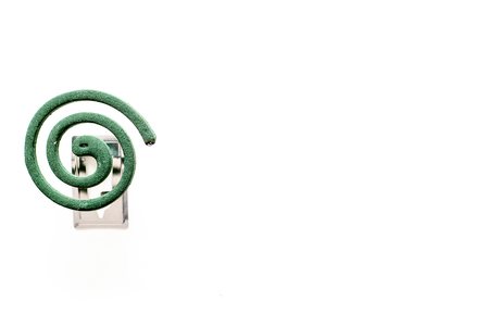 Mosquito repellent for outdoor: garden, summer house, picnic. Green spiral on white background top view space for text Archivio Fotografico - 108959311