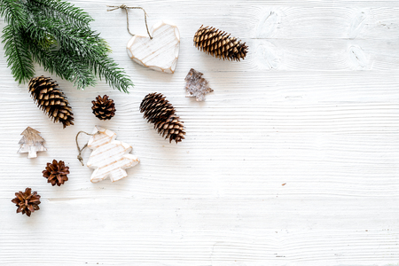 Christmas background. Spruce branch, cones and toys for decoration on white background top view space for text Stock fotó