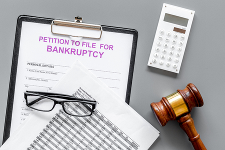 Petition to file for bankruptcy. Empty form ready to fill near calculator and judge gavel on grey background top view Standard-Bild - 109073100