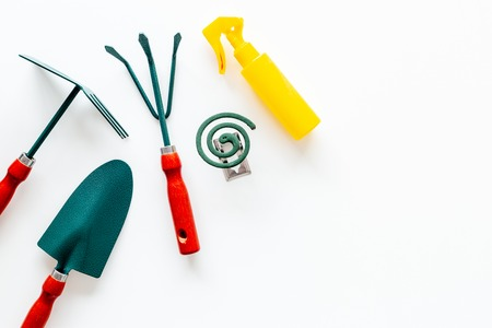 Mosquito protection for garden. Mosquito coil and spray near garden tools on white background top view copy space Banque d'images - 109207755