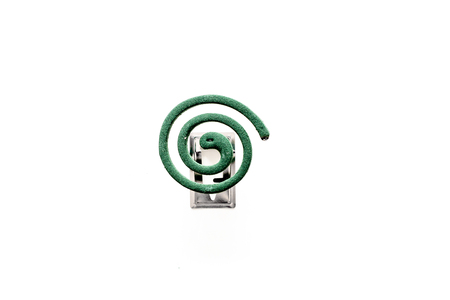Mosquito repellent for outdoor: garden, summer house, picnic. Green spiral on white background top view space for text Archivio Fotografico - 109207758