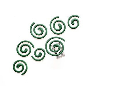 Mosquito repellent for outdoor. Green spiral on white background top view copy space pattern Archivio Fotografico - 109371449