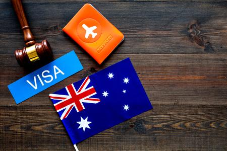 Immigation concept. Text immigation near passport cover and flag. Reklamní fotografie