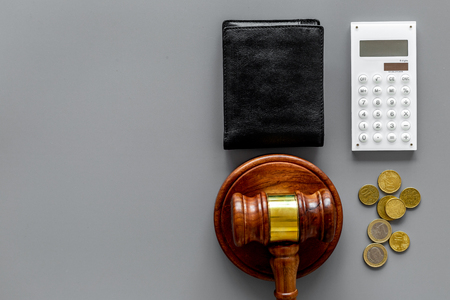 Financial failure, bankruptcy concept. Judge gavel, wallet, coins calculator on grey background Stock Photo