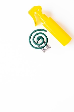 Mosquito protectors. Individual and for open space. Green spiral and spray on white background top view. Archivio Fotografico - 109542687