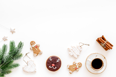 Gignerbread cookies for New Year 2019. Gingerbread man and cookies in shape of heart and new year spruce near cinnamon on white background top view copy space Banco de Imagens