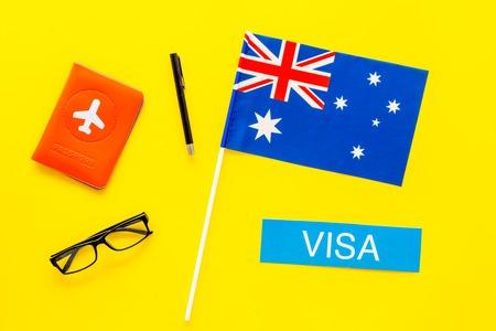Immigation concept. Text immigation near passport cover and flag. Banco de Imagens