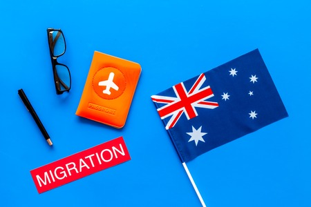 Immigation concept. Text immigation near passport cover and flag. 版權商用圖片