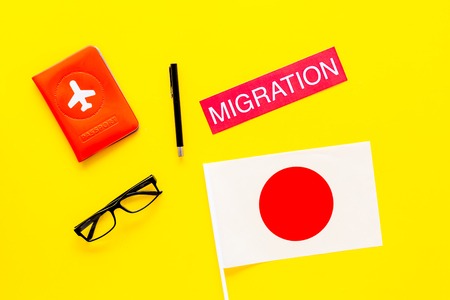 Immigation concept. Text immigation near passport cover and flag. Stockfoto