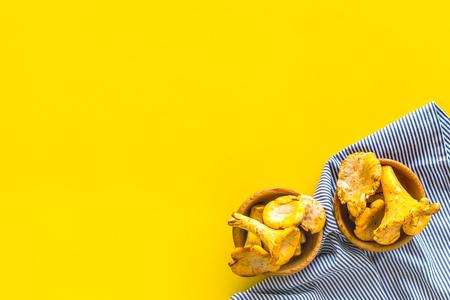Chanterelle mushroom. Fresh raw chanterelles on yellow background top view copy space