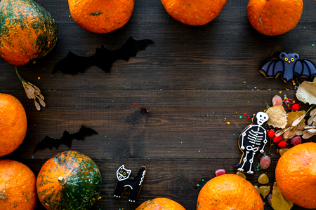 Halloween concept, halloween mood. Pumpkins and cute figures of halloween evils. Skeleton, bats. dark wooden background top view copy space Stock Photo