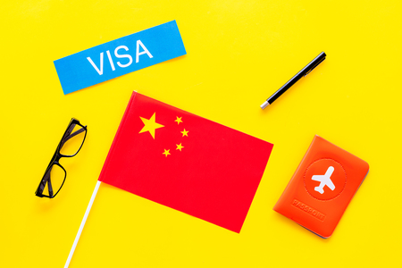 Visa concept. Text visa near passport cover and flag.