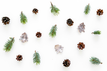 New Year pattern with pine sprigs, cones, spruce figure, fir oil on white background top view. Stock Photo