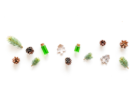 Winter ornament, New Year pattern. Pine sprigs, cones, spruce figure, fir oil on white background top view. Stock Photo