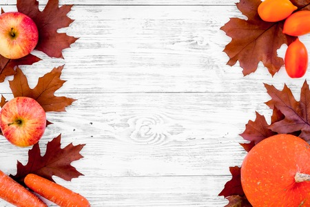 Autumn nature concept. Background with autumn symbols on white wooden background top view