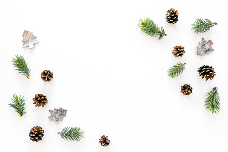 Winter ornament, New Year pattern. Pine sprigs, cones, spruce figure, fir oil on white background top view space for text Stok Fotoğraf