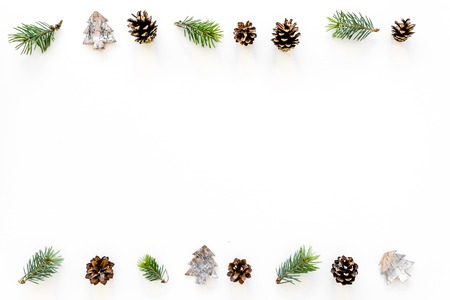Winter ornament, New Year pattern. Pine sprigs, cones, spruce figure, fir oil on white background top view copy space