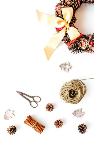 Matherials and instruments for festive christmas wreath made of pine cones on white wooden background top view space for text Stock Photo