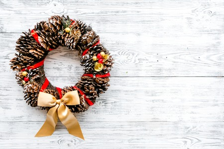 Christmas wreath made of pine cones on white wooden background top view copy space Stock Photo