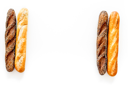 Baguettes. White and brown on white background top view. 版權商用圖片