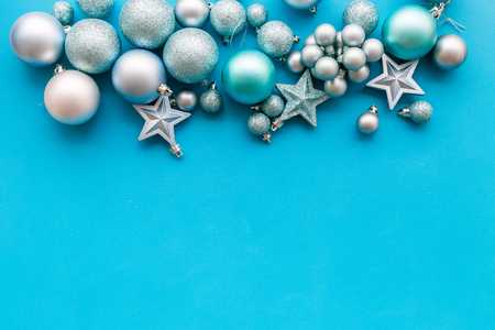 Christmas tree toys background. Blue balls and stars on blue background top view copy space border Stock Photo