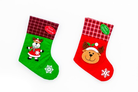 Christmas socks. Traditional decorative socks for small gifts on white background top view.
