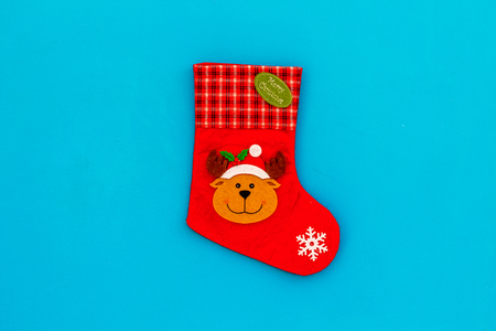 Traditional christmas stocking on blue background top view.
