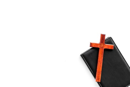 Farewell ceremony, funeral concept. Wooden cross on Bible on white background top view copy space 写真素材