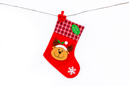 Decorative Christmas socks. Empty socks for gift hanging off a thread on white background top view copy space