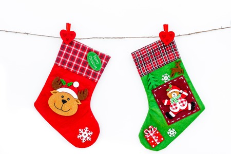 Decorative christmas socks. Empty socks for gift hanging off a thread on white background top view Stock Photo