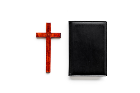 Farewell ceremony, funeral concept. Wooden cross on Bible on white background top view space for text Banco de Imagens - 112604686