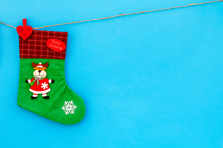 Decorative christmas socks. Empty socks for gift hanging off a thread on blue background top view. Stock Photo