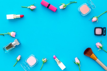 Makeup products for young girls on blue background Stock Photo