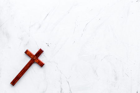 Funeral concept. Wooden cross on white stone background 写真素材